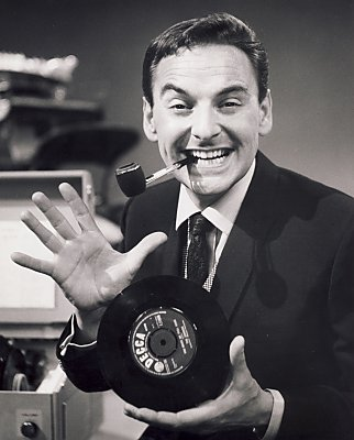 Bob Monkhouse with record and pipe